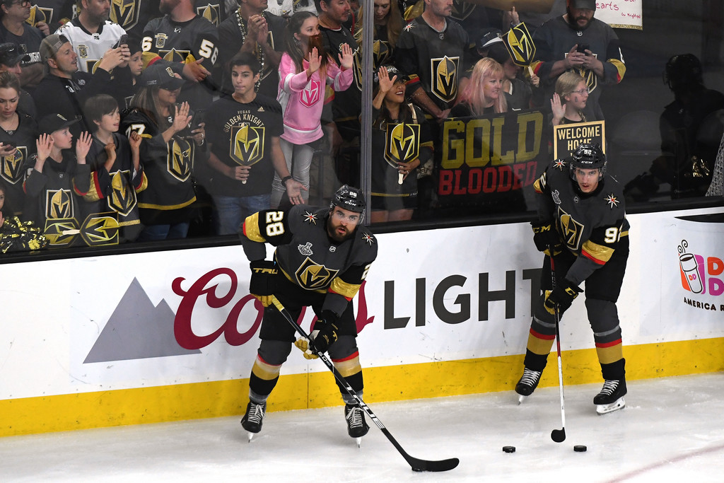 Vegas Golden Knights fourth line players William Carrier and Tomas Nosek line up with pucks during warm-ups for Game 5 of the 2018 Stanley Cup Finals